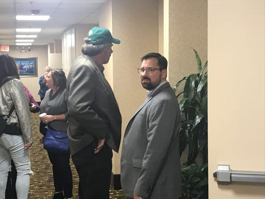 Rep. Doug LaMalfa, center, and his chief of staff, Mark Spannagel, talk outside LaMalfa's election party at Chico's Ramada hotel Tuesday night.