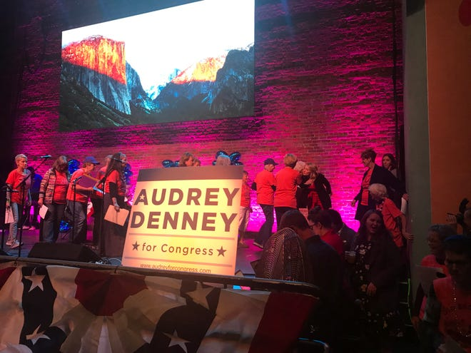 """Democratic congressional candidate Audrey Denney, third from right, hugs members of the """"Old Broads for Audrey"""" singing group after they performed at her election party Tuesday night at Chico's El Rey Theater."""