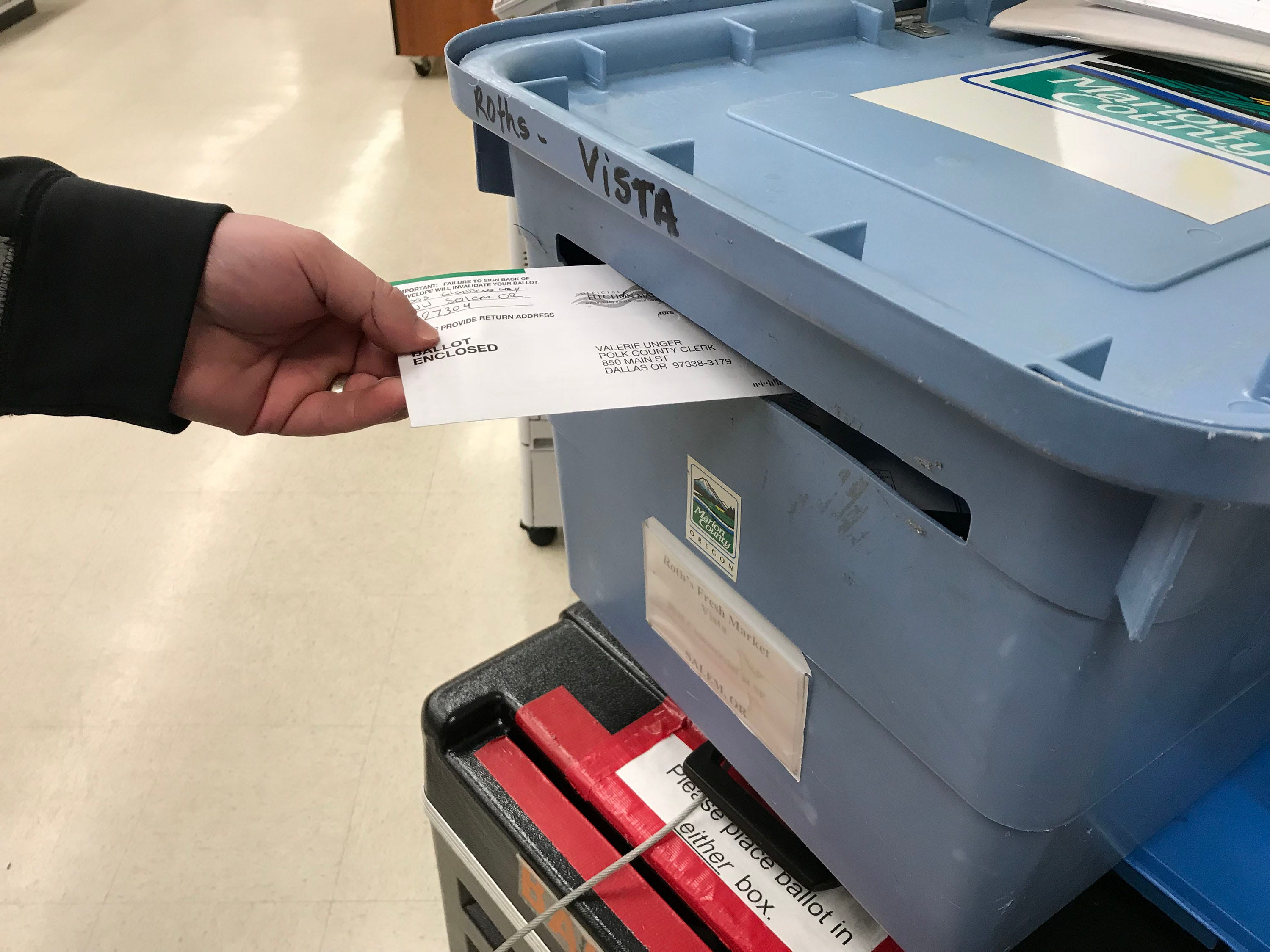 Voters drop off ballots before the deadline Tuesday evening, November 6, 2018 at the Roth's on Commercial Street SE in Salem.