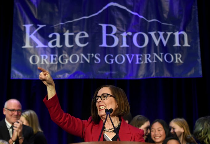 Gov. Kate Brown addresses the crowd after winning re-election in Portland, Ore., Tuesday, Nov. 6, 2018.