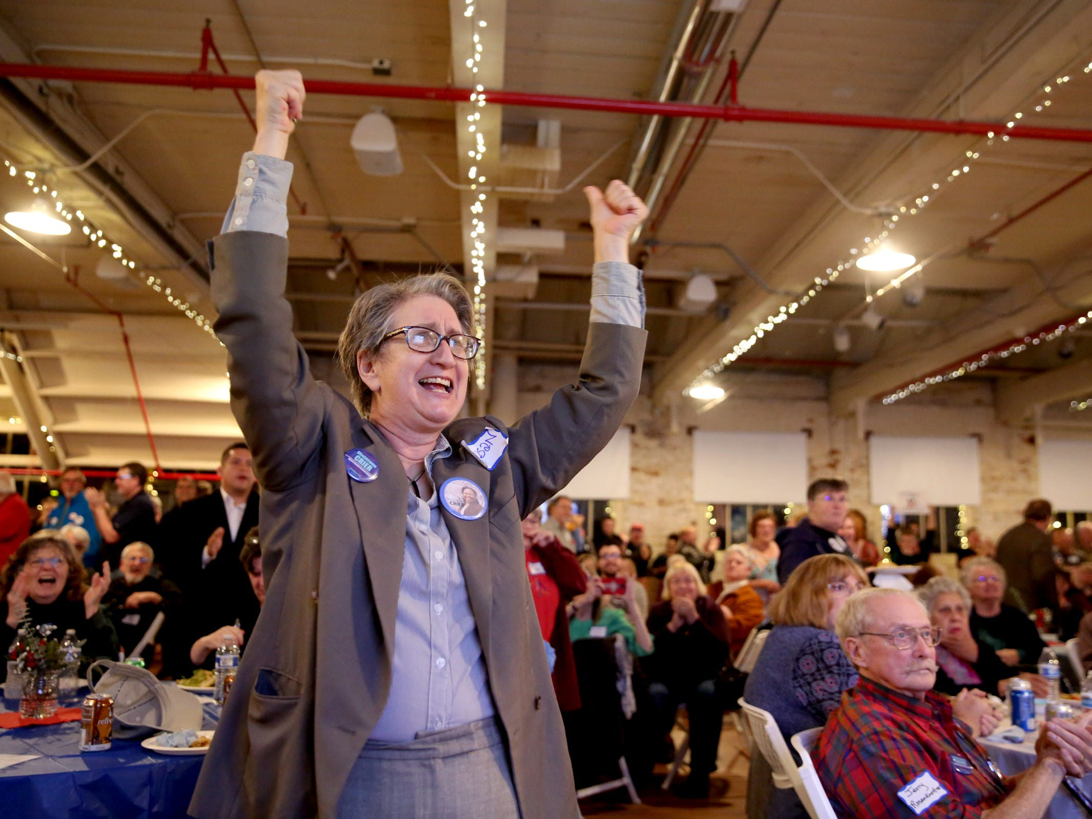 Susan Smith, the campaign manager for Shelaswau Crier, a candidate for Marion County Commissioner, cheers as initial results for Oregon ballot measures are posted during an election night party hosted by Marion County Democrats and Polk County Democrats at the Willamette Heritage Center in Salem on Tuesday, Nov. 6, 2018.