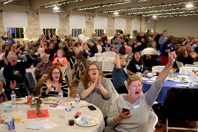 People cheer as the initial governor's race results are posted during an election night party hosted by Marion County Democrats and Polk County Democrats at the Willamette Heritage Center in Salem on Tuesday, Nov. 6, 2018.