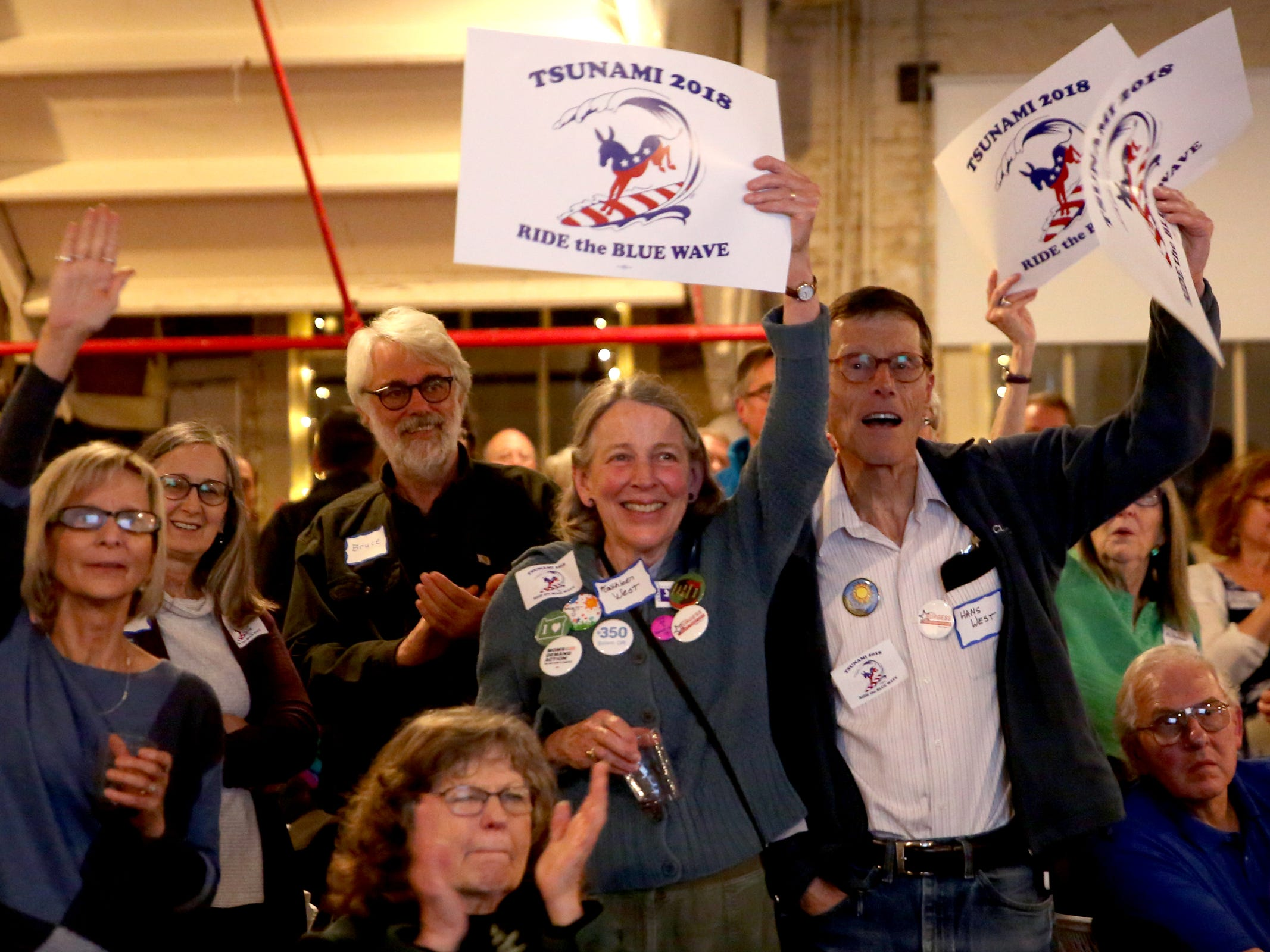 People cheer during an election night party hosted by Marion County Democrats and Polk County Democrats at the Willamette Heritage Center in Salem on Tuesday, Nov. 6, 2018.
