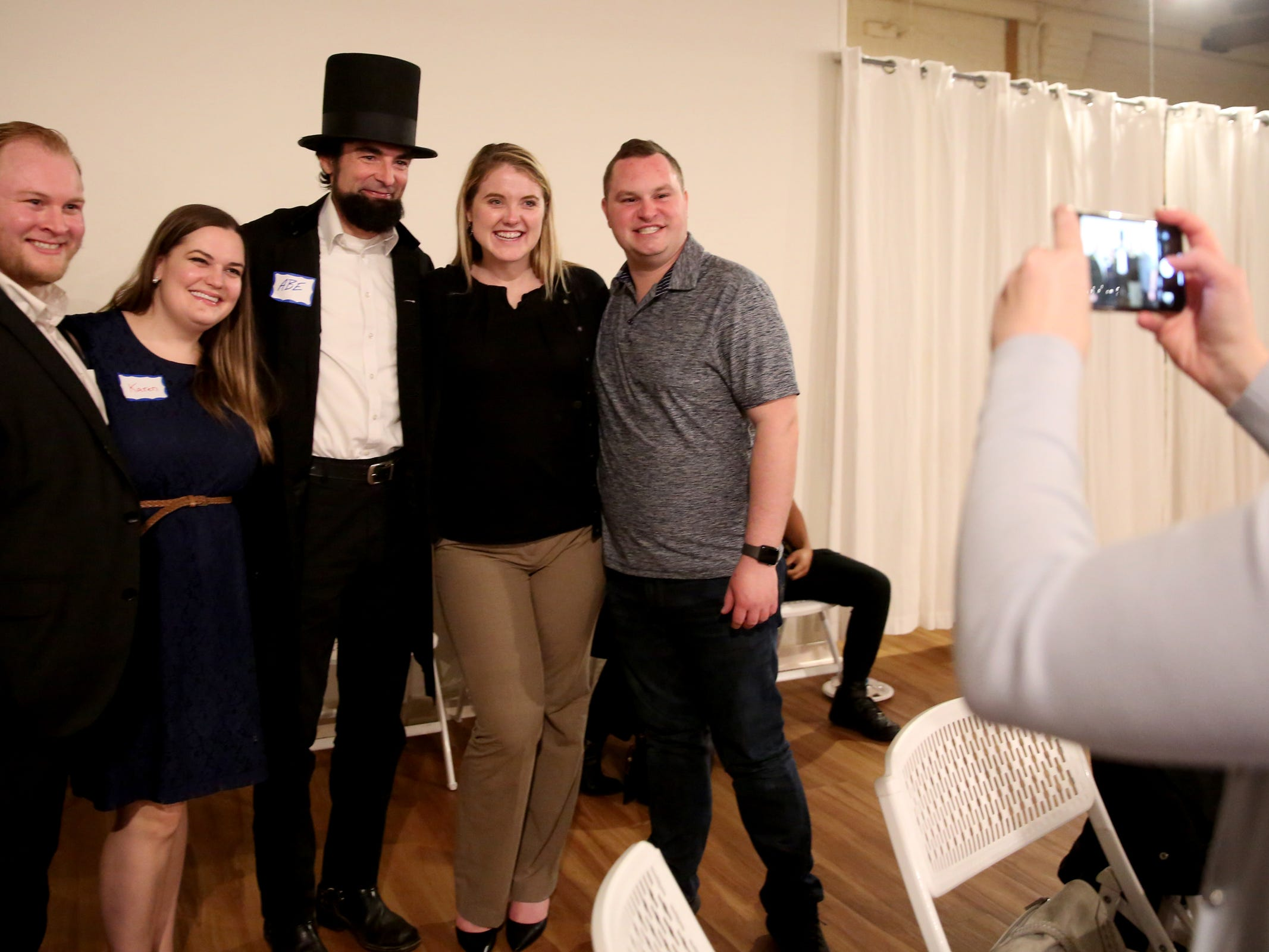 People take a photo with an Abraham Lincoln impersonator during an election night party hosted by Marion County Democrats and Polk County Democrats at the Willamette Heritage Center in Salem on Tuesday, Nov. 6, 2018.