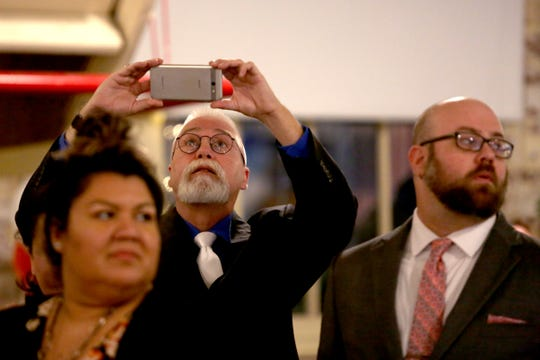 Dave McCall, a candidate for the Oregon House of Representatives to represent District 25, takes a photo during an election night party hosted by Marion County Democrats and Polk County Democrats at the Willamette Heritage Center in Salem on Tuesday, Nov. 6, 2018.