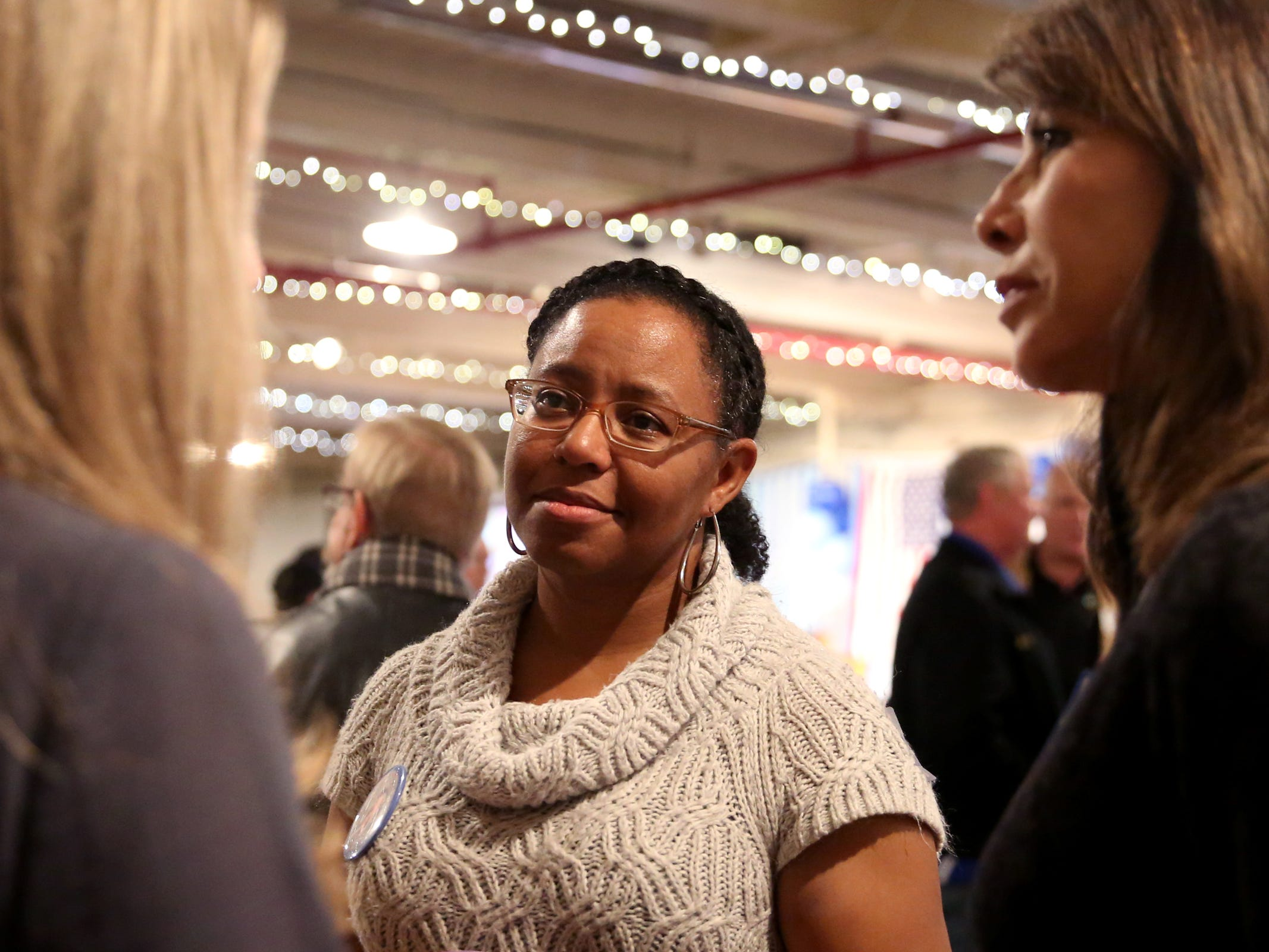 Shelaswau Crier, a candidate for Marion County Commissioner, speaks with supporters during an election night party hosted by Marion County Democrats and Polk County Democrats at the Willamette Heritage Center in Salem on Tuesday, Nov. 6, 2018.