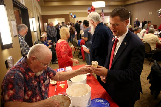 Mark Callahan (R), candidate for Oregon's 5th Congressional District, is served ice cream