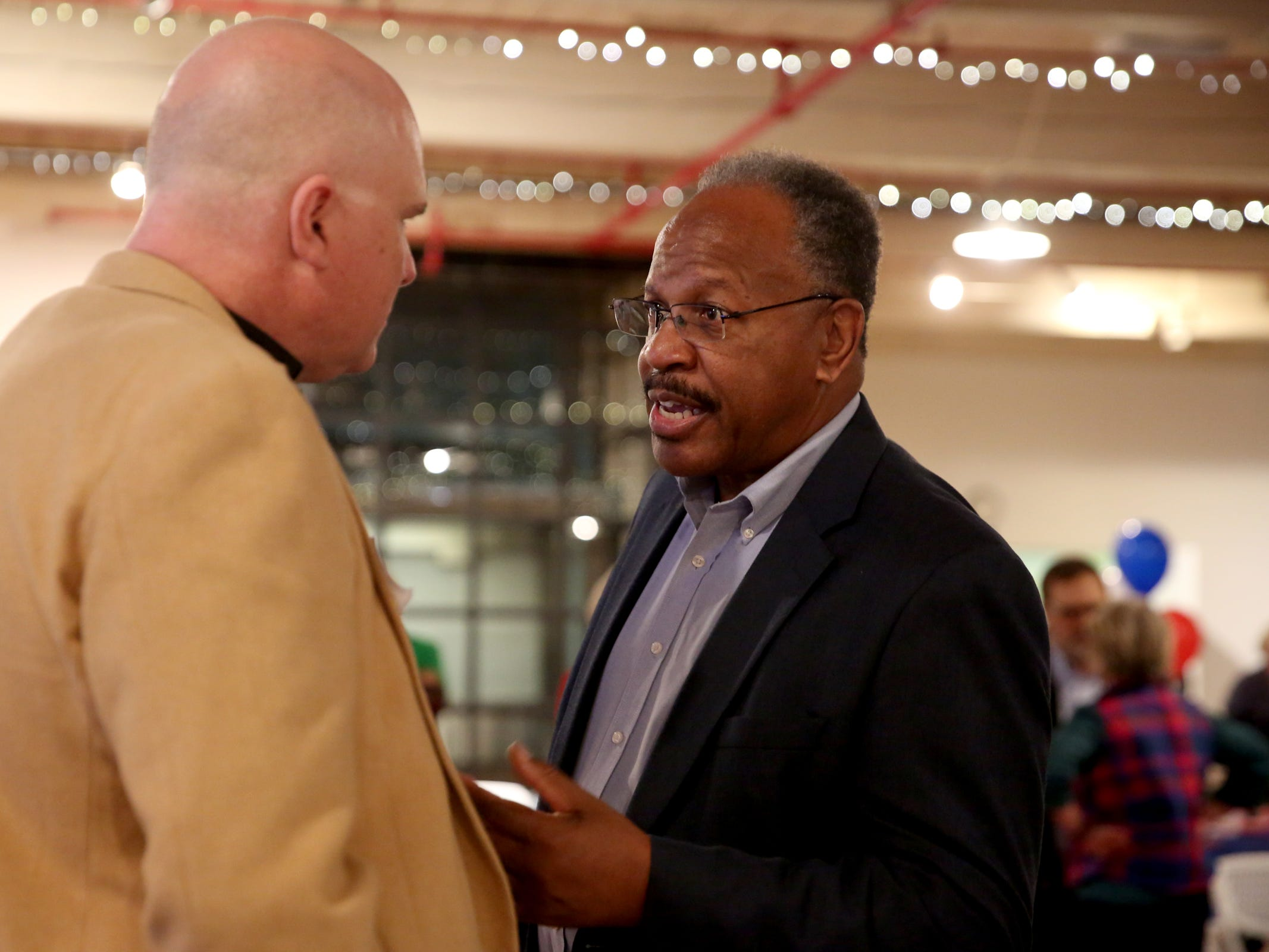 Benny Williams, right, the president of the Salem-Keizer branch of the NAACP, speaks with Sean Nikas, the small business caucus chair of the Democratic Party of Oregon, during an election night party hosted by Marion County Democrats and Polk County Democrats at the Willamette Heritage Center in Salem on Tuesday, Nov. 6, 2018.