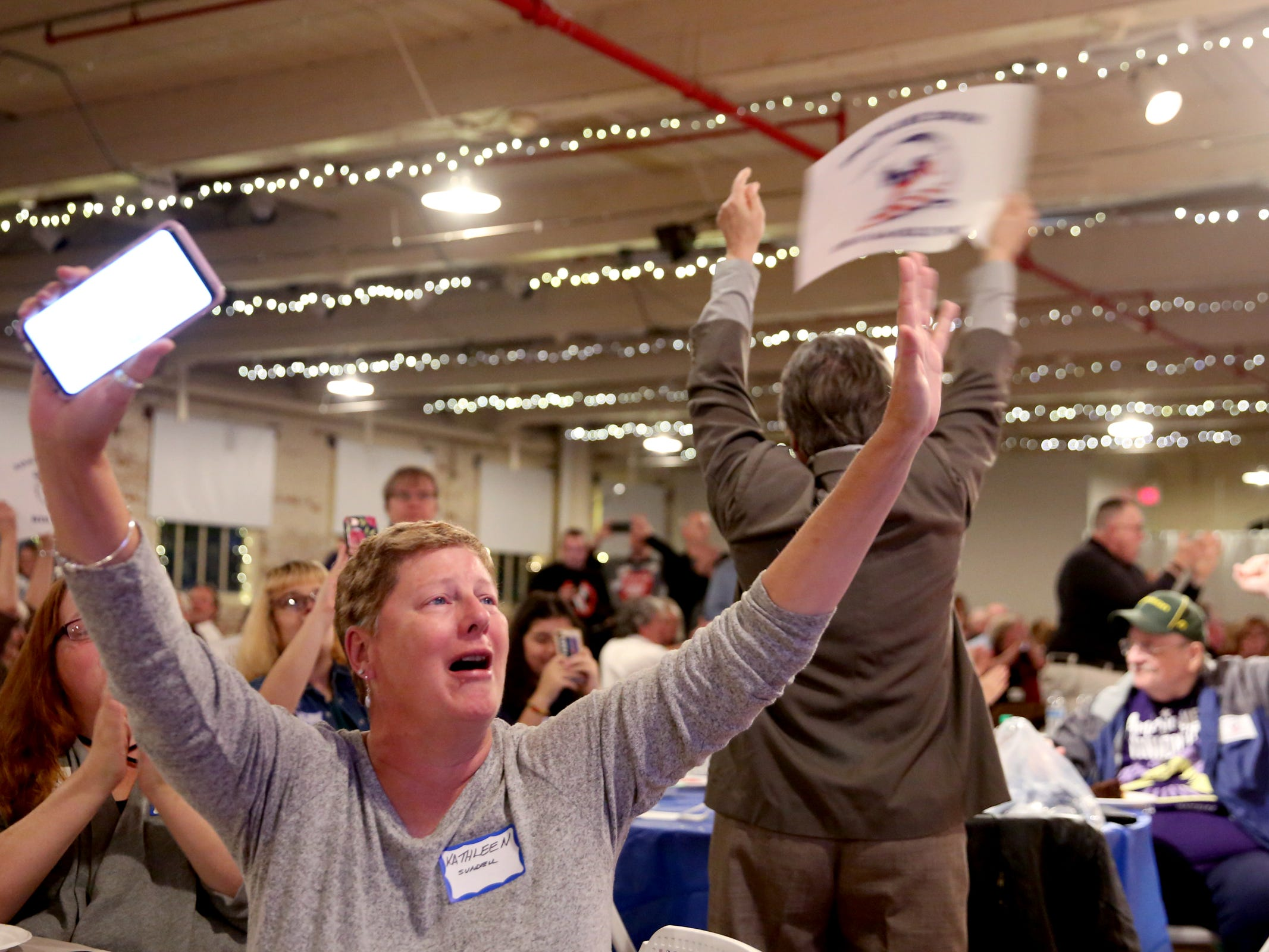 Kathleen Sundell, of Salem, cheers as results come in during an election night party hosted by Marion County Democrats and Polk County Democrats at the Willamette Heritage Center in Salem on Tuesday, Nov. 6, 2018.