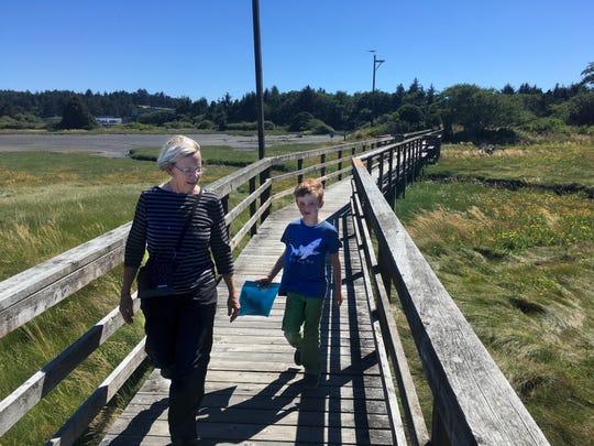 Oregon Coast Aquarium boardwalk On Estuary Trail With Janell Sorensen and Brendan Sullivan walk along the boardwalk on the Estuary Trail near the Oregon Coast Aquarium.