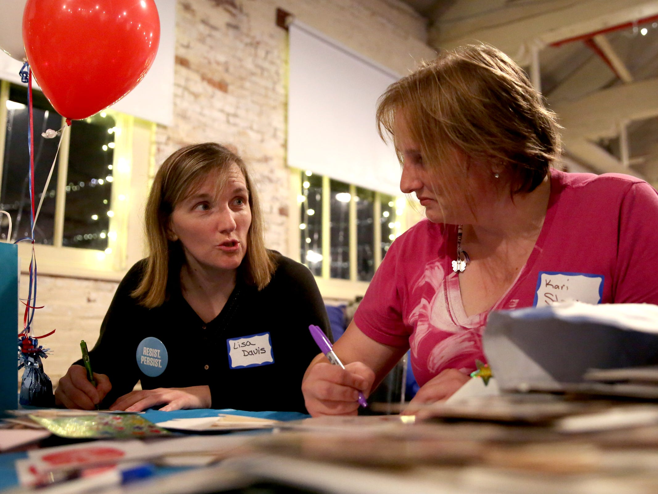 Lisa Davis, left, of Keizer, and Kari Stocks, of Salem, write thank you notes to candidates during an election night party hosted by Marion County Democrats and Polk County Democrats at the Willamette Heritage Center in Salem on Tuesday, Nov. 6, 2018.