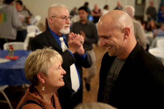 Deb Patterson, left, a candidate for Senate District 10, speaks with Mike Ellison, a candidate for House District 19, as Dave McCall, a candidate for House District 25 stands by during an election night party hosted by Marion County Democrats and Polk County Democrats at the Willamette Heritage Center in Salem on Tuesday, Nov. 6, 2018.