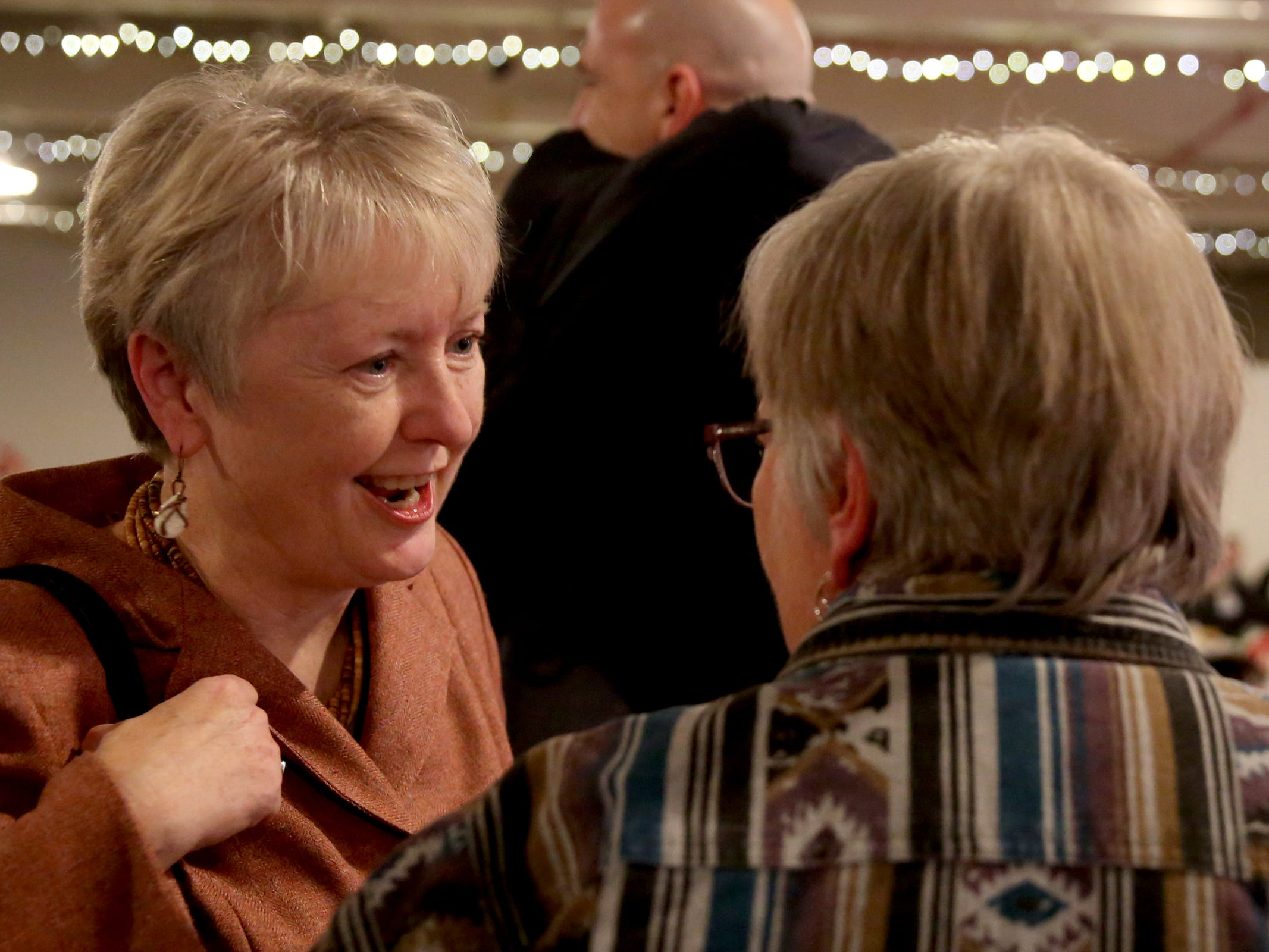 Deb Patterson, left, a candidate for Senate District 10, speaks with HariGun Khalsa, of Salem, during an election night party hosted by Marion County Democrats and Polk County Democrats at the Willamette Heritage Center in Salem on Tuesday, Nov. 6, 2018.
