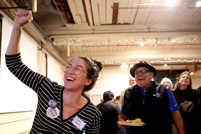 Sadie Carney, of Salem, and Roland Herrera, a Keizer City Councilor, cheer as initial results for Measure 105 are posted during an election night party hosted by Marion County Democrats and Polk County Democrats at the Willamette Heritage Center in Salem on Tuesday, Nov. 6, 2018.