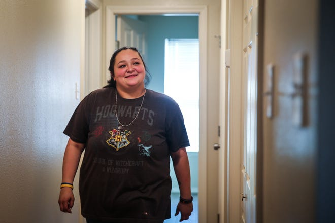 Heather Sanchez walks down the hallway in the Galilee CDC transitional home she will be renting Tuesday, Nov. 6, 2018, in San Angelo.