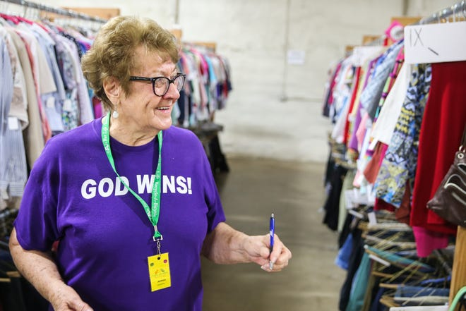 Jeorgia Brassell, volunteer, walks through the clothing section Wednesday, Nov. 7, 2018, at Rust Street Ministries.