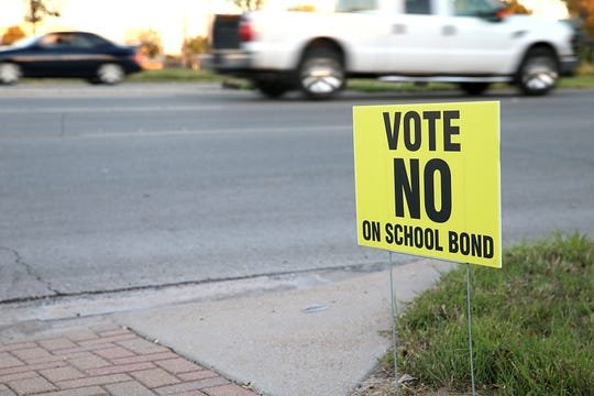 A sign opposing the San Angelo ISD's bond is planted near the street Nov. 6, 2018 on Bryant Blvd.