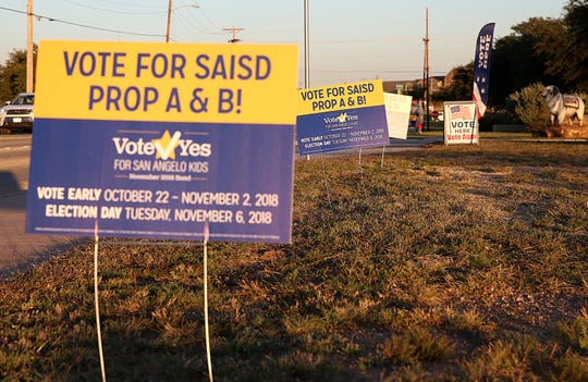 Signs supporting the San Angelo ISD's bond are planted in front of a polling site Nov. 6, 2018 on University Blvd.