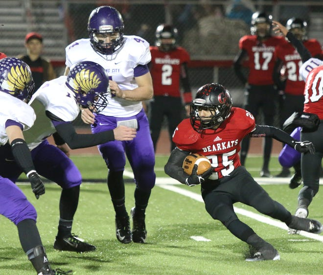 Garden City High School's Angel Zuniga faces the Sterling City defense during the first quarter of a playoff game at Bearkat Stadium in Garden City on Nov. 14, 2014.