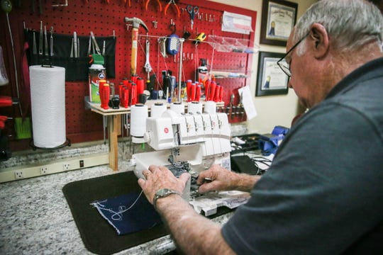 George Cooper works on a machine Nov. 1, 2018, at Creative Stitches.