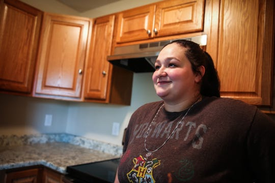 Heather Sanchez stands in the kitchen of a Galilee CDC transitional home Tuesday, Nov. 6, 2018, in San Angelo.