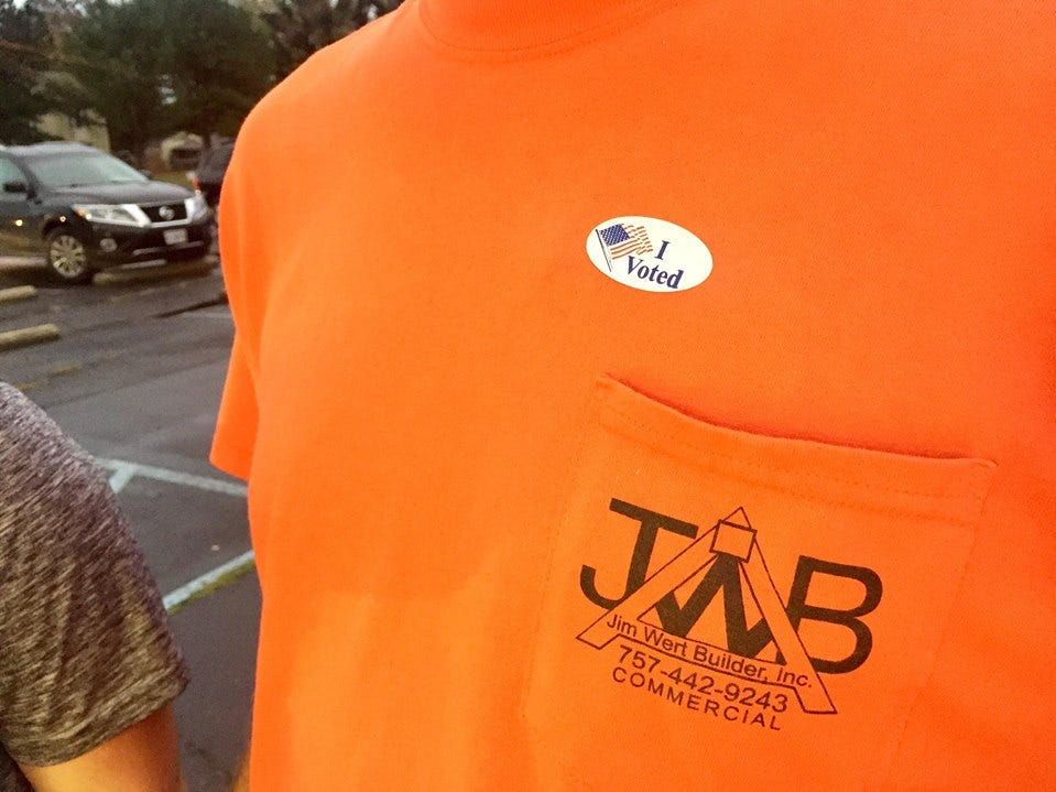 Jeremy Wert wears his voting sticker outside the Melfa firehouse.
