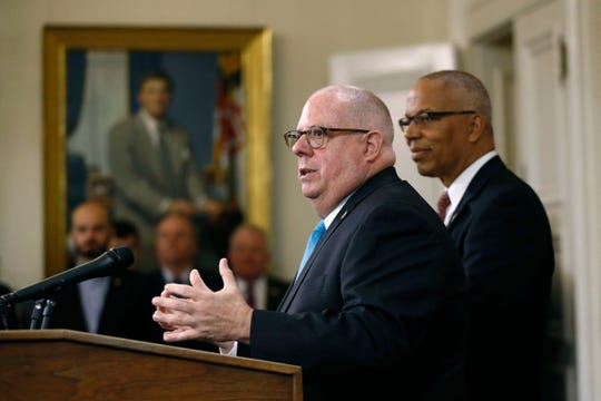 Maryland Gov. Larry Hogan, left, speaks at a news conference alongside Lt. Gov. Boyd Rutherford, Wednesday, Nov. 7, 2018, at the Maryland State House in Annapolis, Md. Hogan earned a second term Tuesday after defeating Democratic opponent Ben Jealous. (AP Photo/Patrick Semansky)