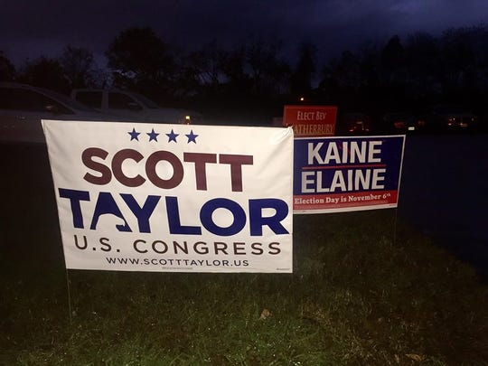 Campaign signs outside the Exmore Fire Hall voting precinct.