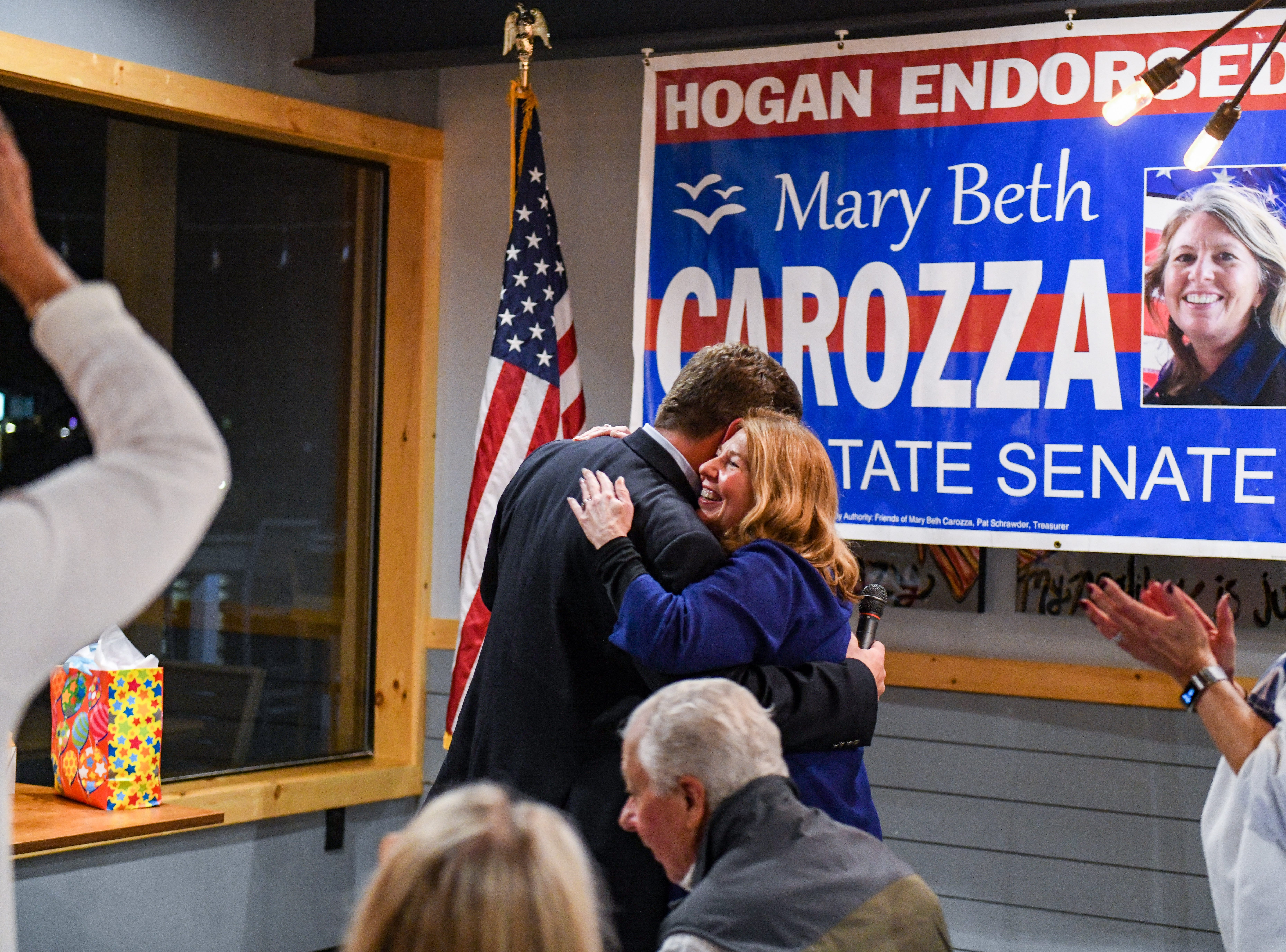 Newly elected Maryland delegate Wayne Hartman introduces Republican Mary Beth Carozza shortly after she was elected the new Maryland state senator in District 38 on Tuesday, Nov 6, 2018.