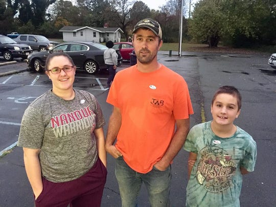 Voter Jeremy Wert with  his daughter Jamie Lyn and son outside the Melfa firehouse on Election Day.