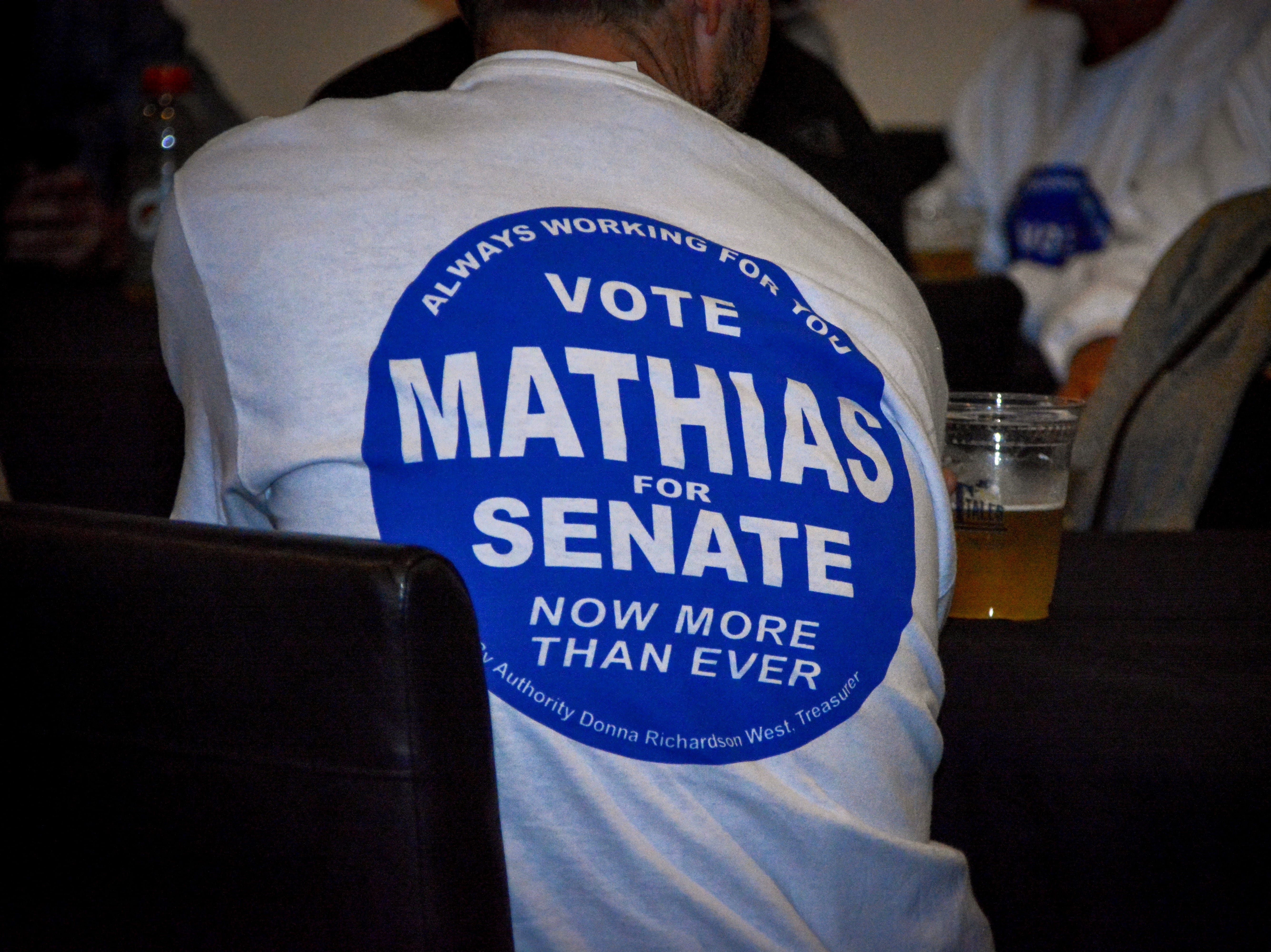 Supporters for Sen. Jim Mathias wear campaign gear at Tall Tales Brewing Company in Parsonsburg for election night on Tuesday, Nov. 6, 2018.