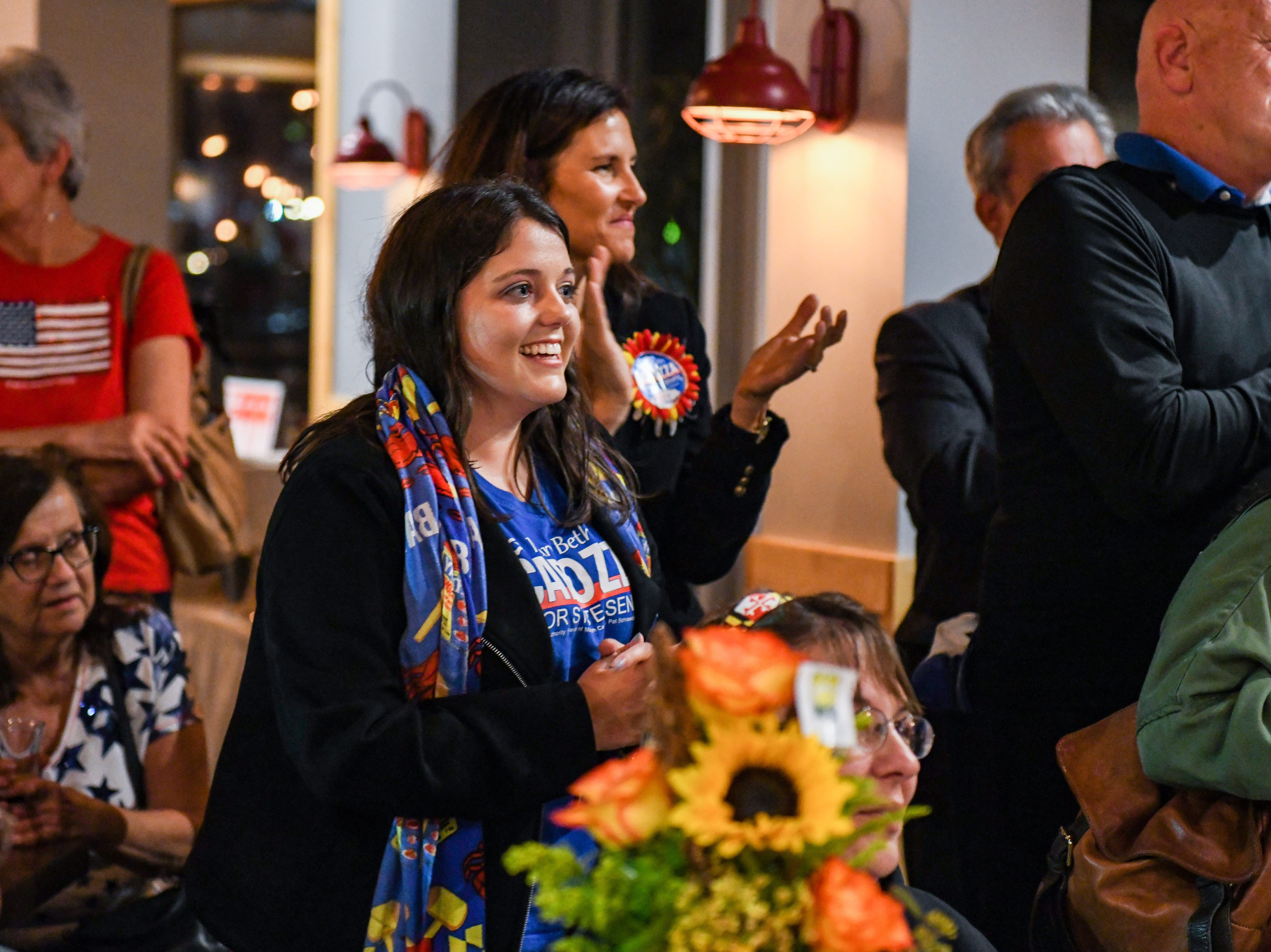 Campaign aide Melissa Brown cheers as Republican Mary Beth Carozza speaks at her Ocean City watch party shortly after she was elected the new Maryland state senator in District 38 on Tuesday, Nov 6, 2018.