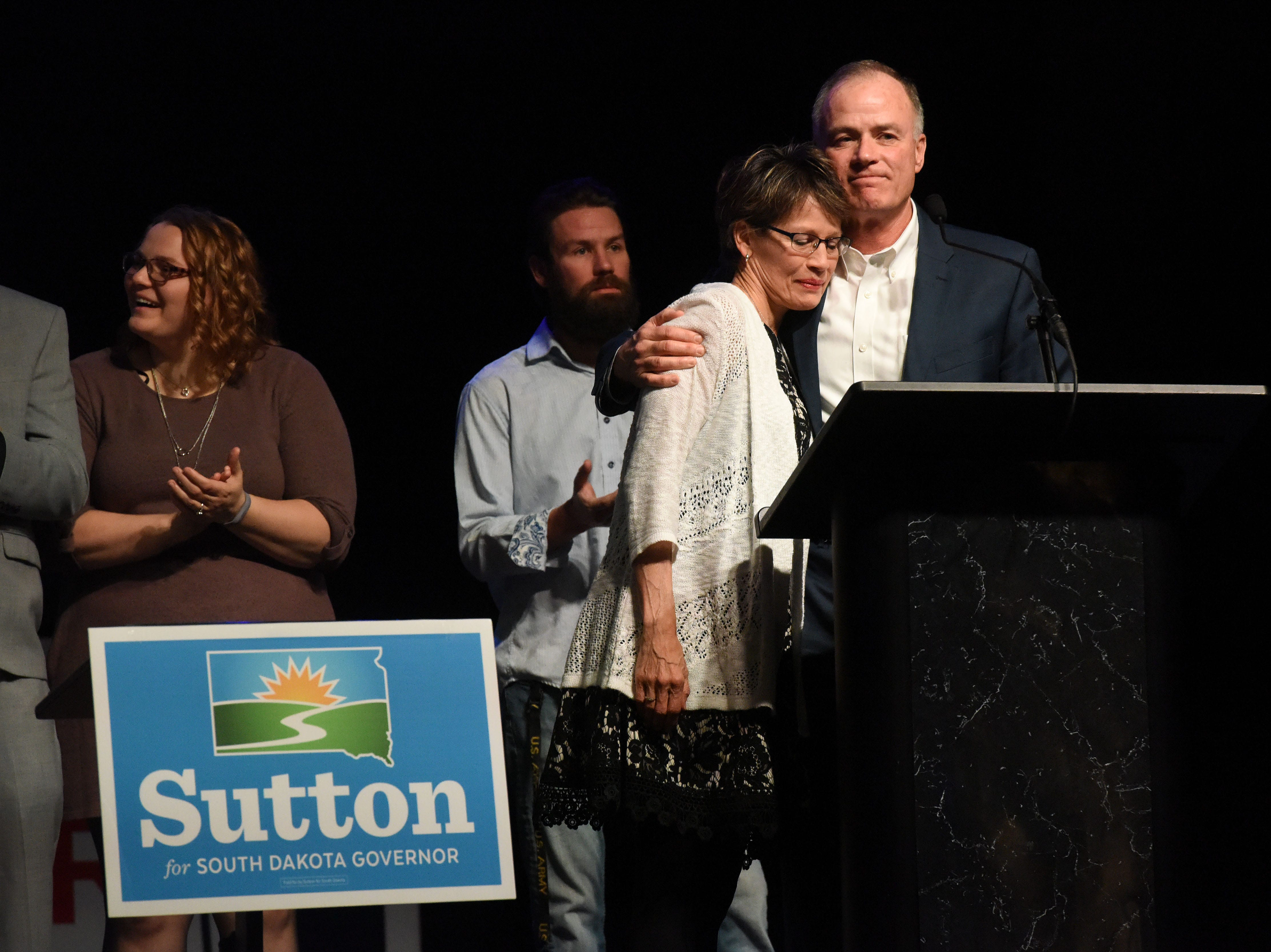 Tim Bjorkman hugs his wife while giving his concession speech after losing the race to Dusty Johnson, Tuesday, Nov. 6, 2018 at The District in Sioux Falls, S.D.