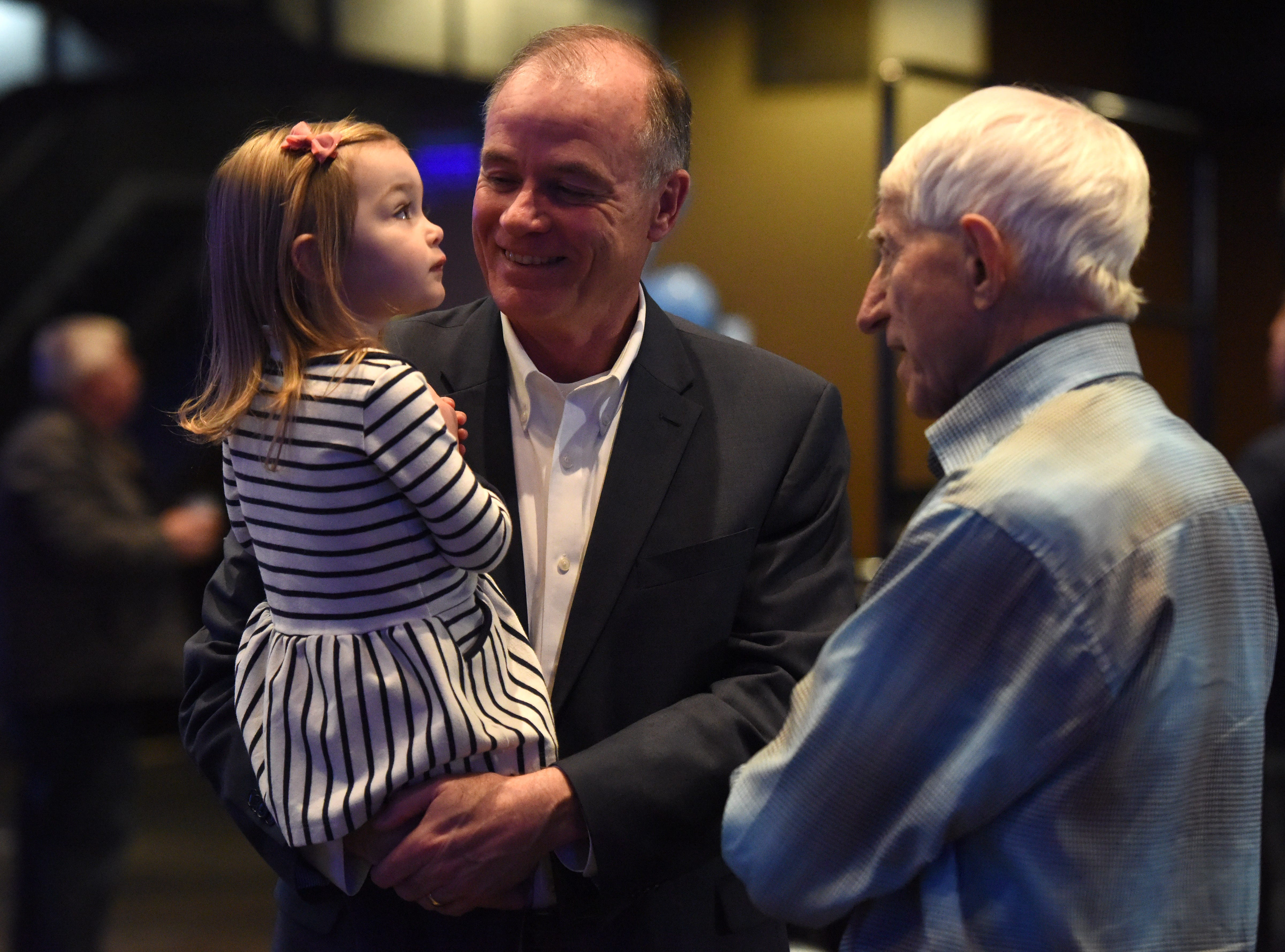 Tim Bjorkman speaks with Mike Saba, district nine candidate, while holding his granddaughter at the Democratic night party, Tuesday, Nov. 6, 2018 at The District in Sioux Falls, S.D.