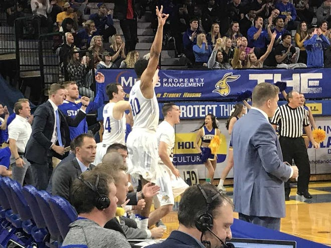 Alou Dillon (10) celebrates a 3-pointer by David Jenkins in SDSU's win over GCU Tuesday at Frost Arena