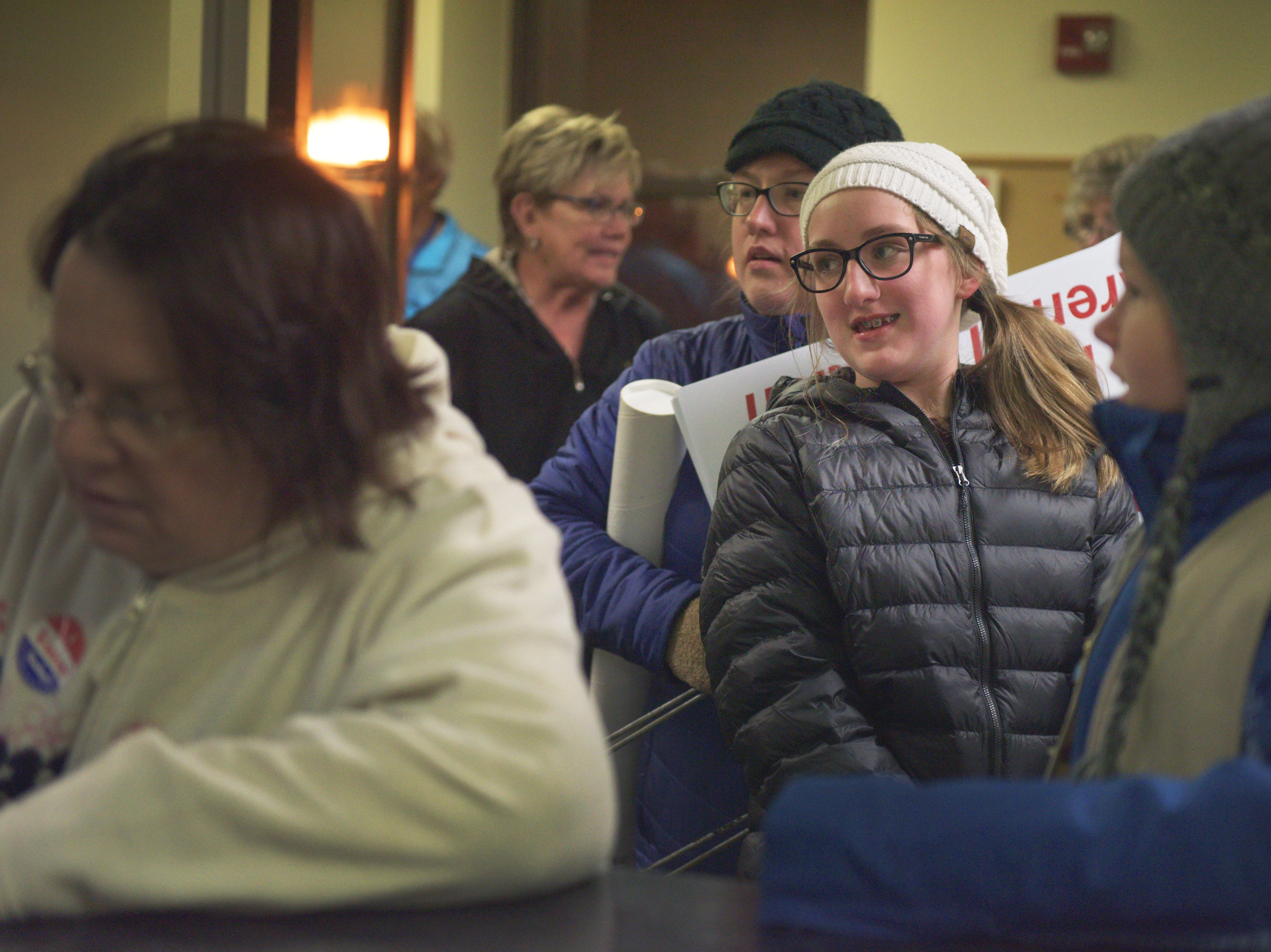 Girl Scout Madeline Brenden helps count ballots Tuesday, Nov. 6, at the Minnehaha County election headquarters  in Sioux Falls.