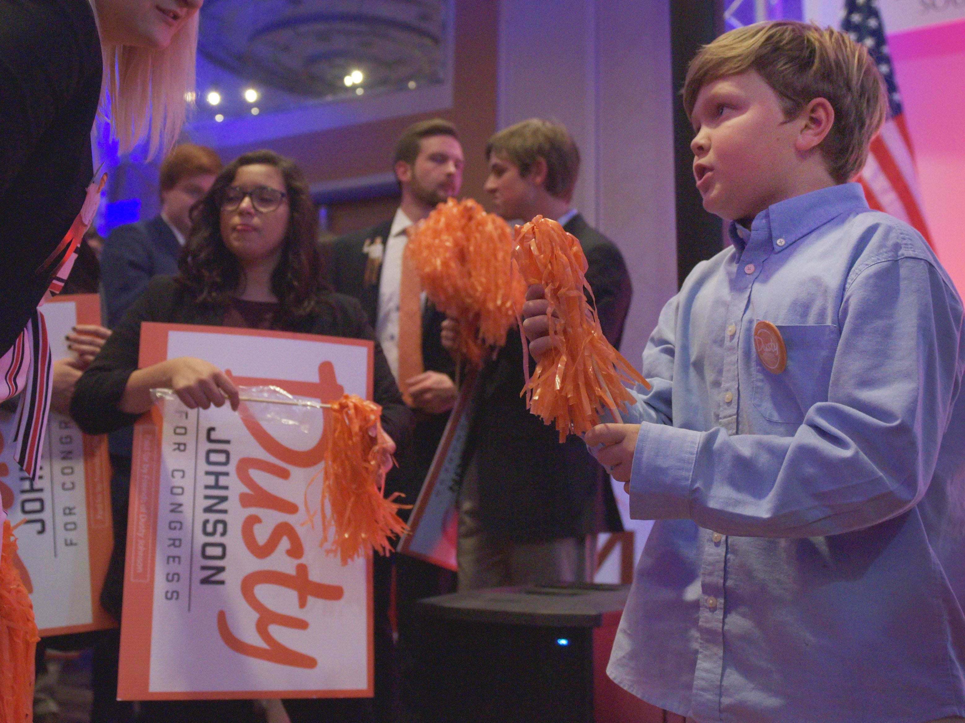 Dusty Johnson's nephew Foster Young runs up to grab a pompom before Johnson speaks to supporters after winning South Dakota's lone U.S. House seat after results are announced Tuesday, Nov. 6, at the Hilton Garden Inn in Sioux Falls.