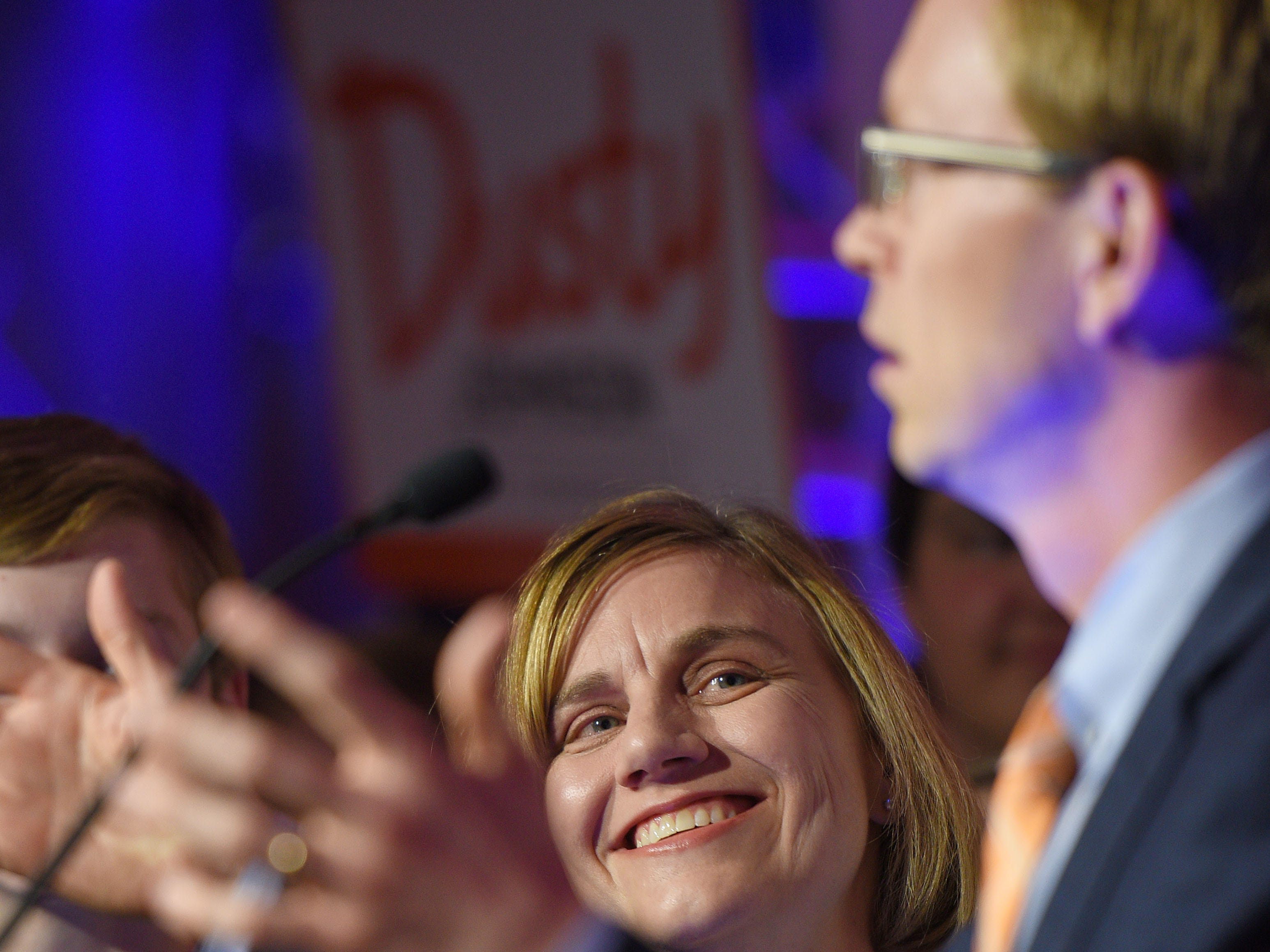 Jacquelyn Johnson looks up at her husband Dusty Johnson while he speaks to supporters after winning South Dakota's lone U.S. House seat after results are announced Tuesday, Nov. 6, at the Hilton Garden Inn in Sioux Falls.
