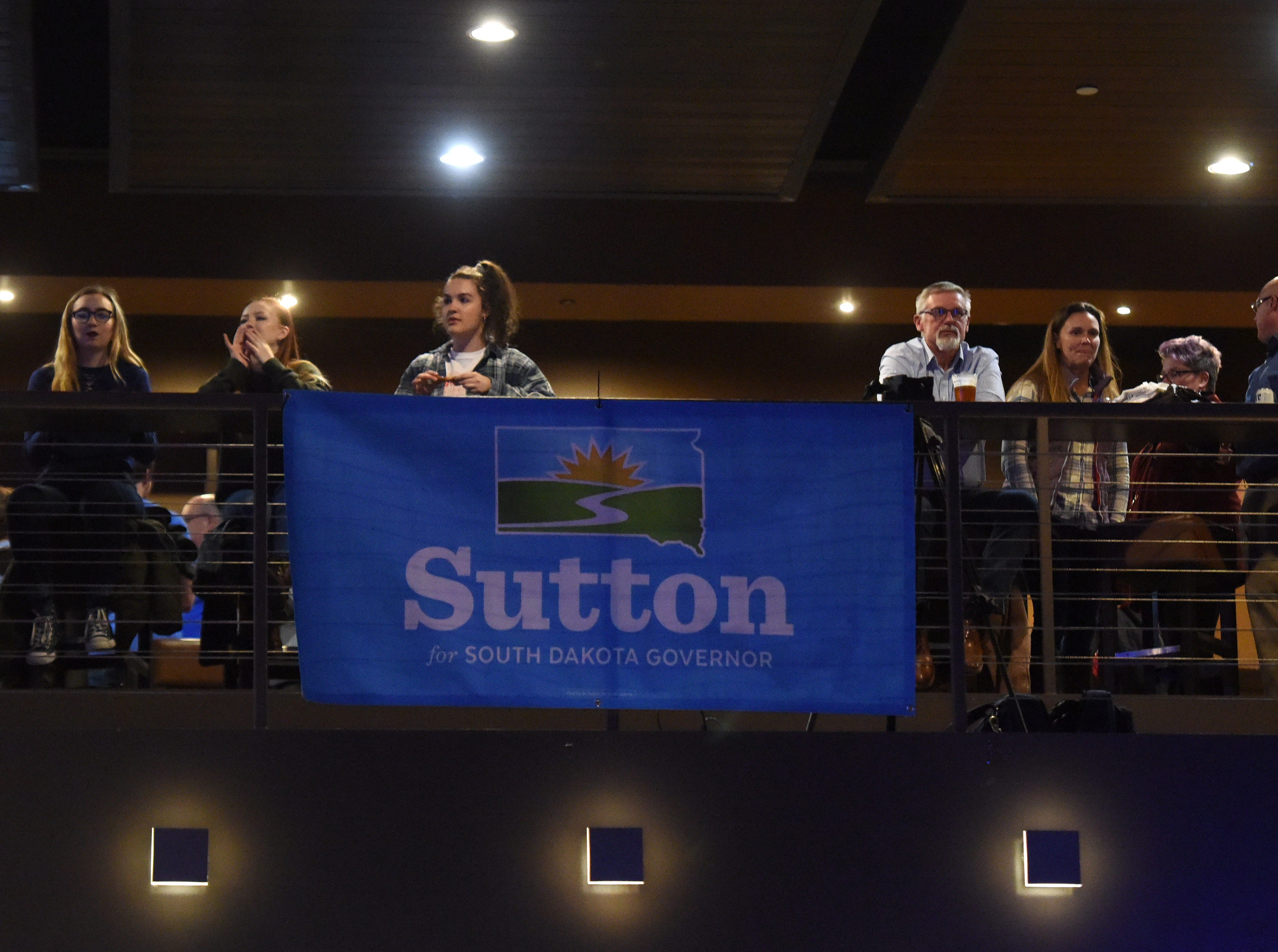 Supporters watch as results come in at the Democratic night party, Tuesday, Nov. 6, 2018 at The District in Sioux Falls, S.D.