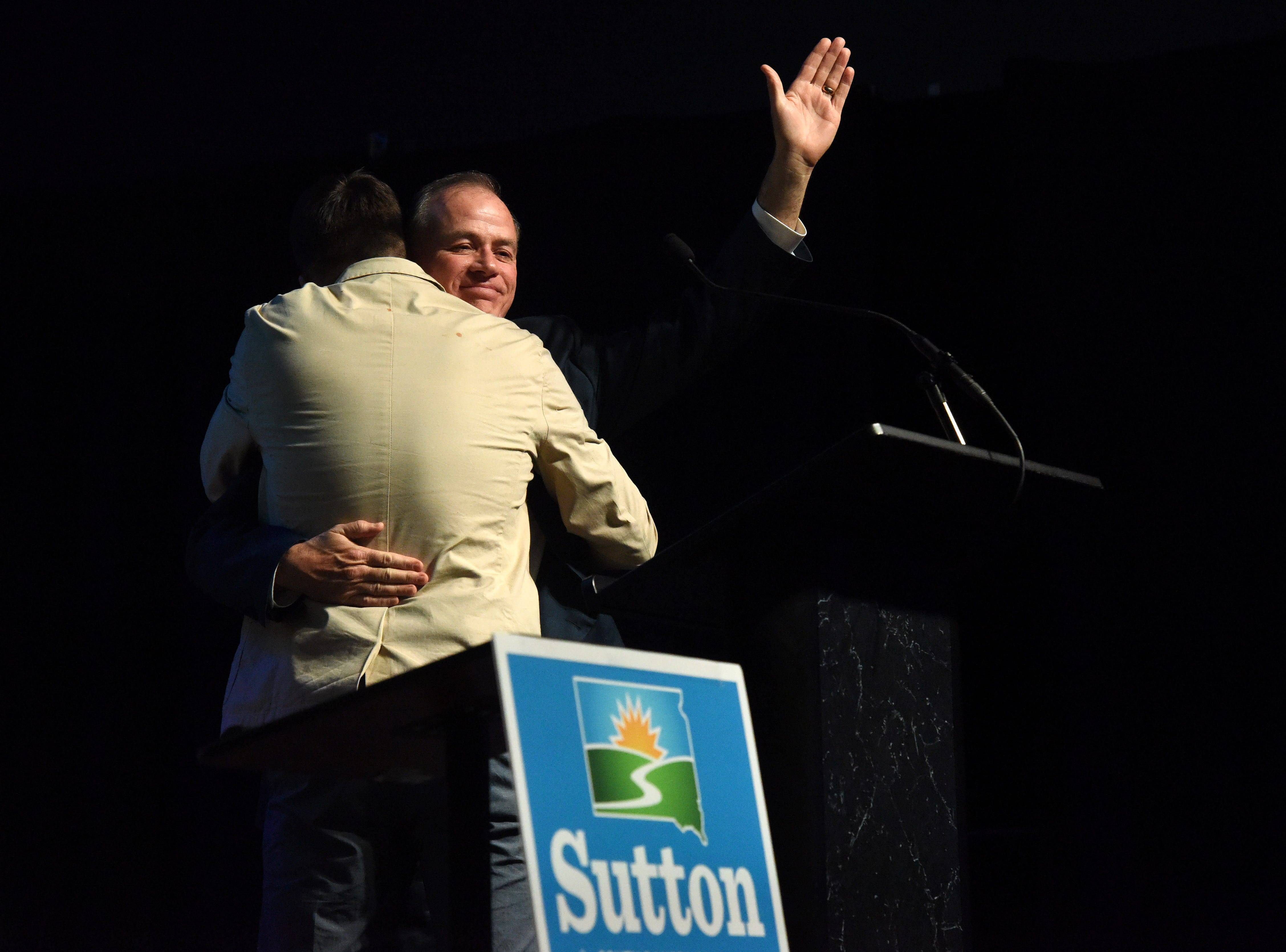 Tim Bjorkman hugs his son before giving his concession speech after losing the race to Dusty Johnson, Tuesday, Nov. 6, 2018 at The District in Sioux Falls, S.D.