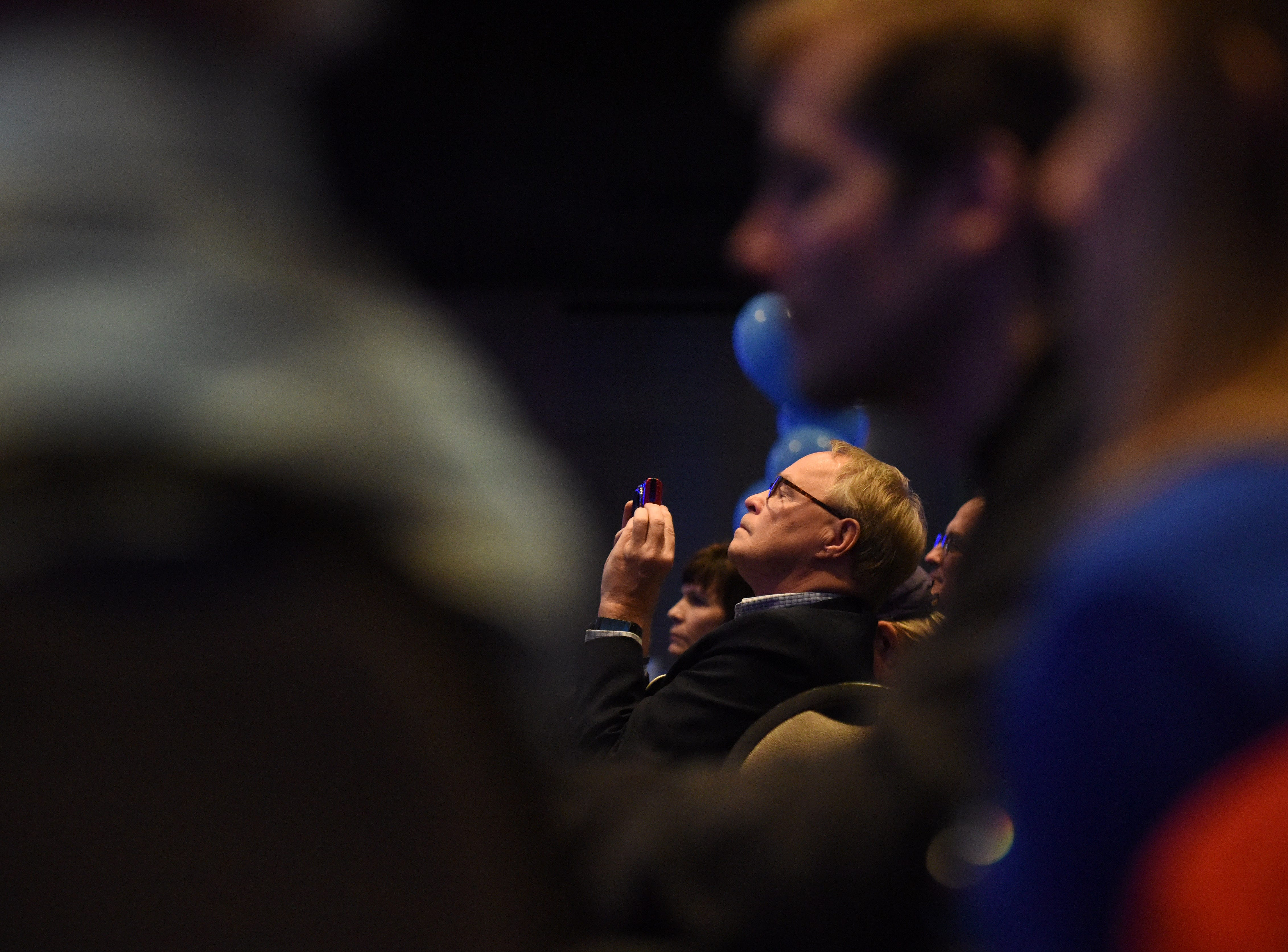 Supporter films Randy Seiler's concession speech at the Democratic election night party, Tuesday, Nov. 6, 2018 at The District in Sioux Falls, S.D.
