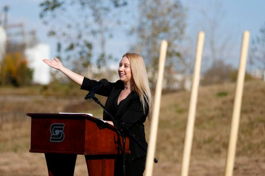 Olivia Hough, brownfields program coordinator for the city of Springfield, talks about the West Meadows project at a groundbreaking for a new trail on Wednesday, Nov. 7, 2018.