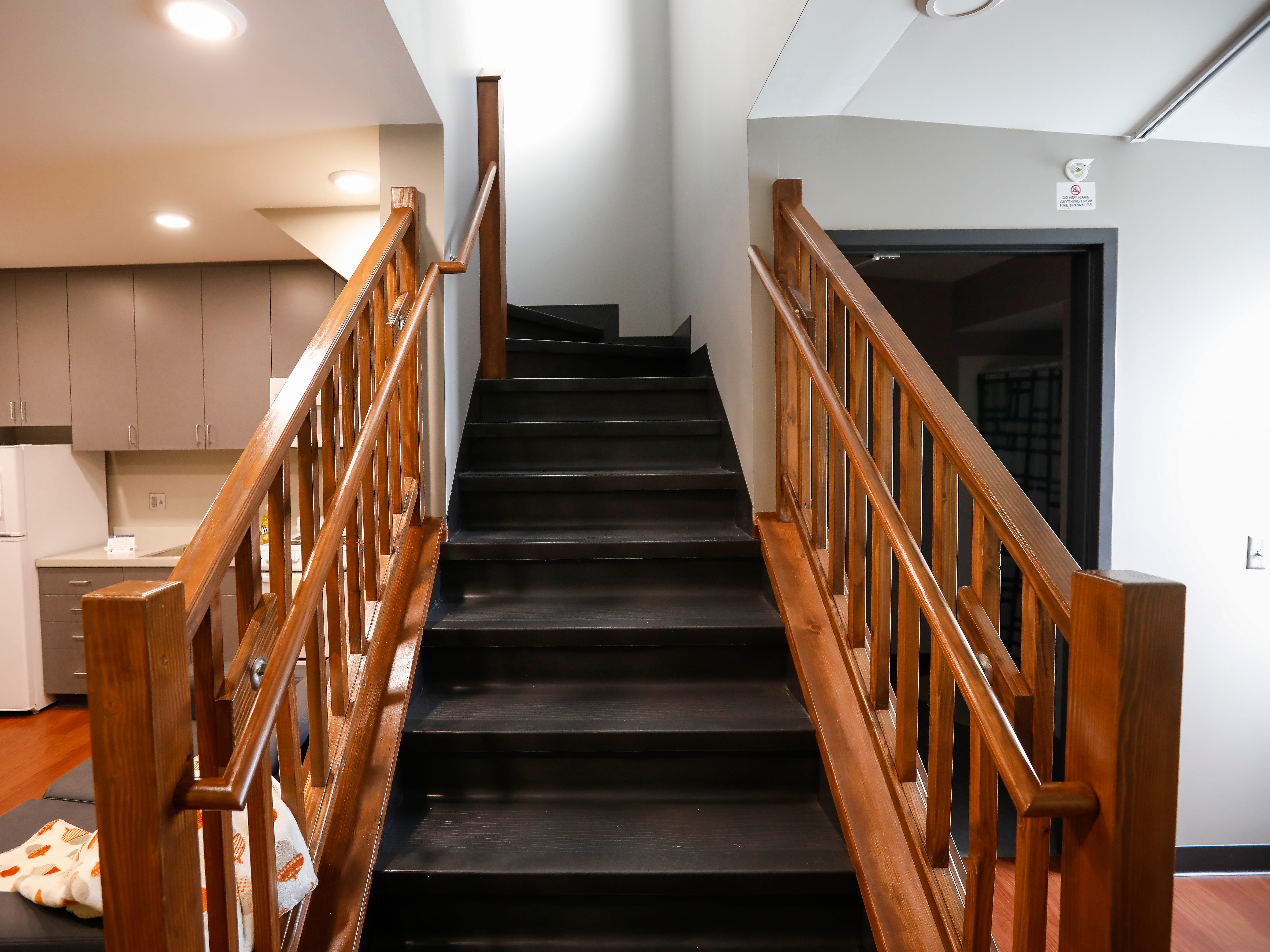 A stairway leads up to the children's rooms inside one of the apartments at The Kitchen's new Emergency Shelter located at 1855 E. Chestnut Expressway.