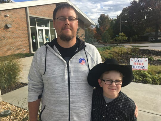 Daniel Routh, 33, brought his son Daniel Routh Jr., 11, to vote with him at Schweitzer Brentwood Branch Library on Nov. 6, 2018.
