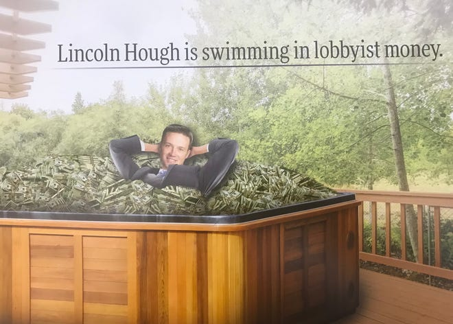 A Democratic PAC took aim at Missouri state Senate candidate Lincoln Hough and photo-shopped him into a hot tub filled with cash.