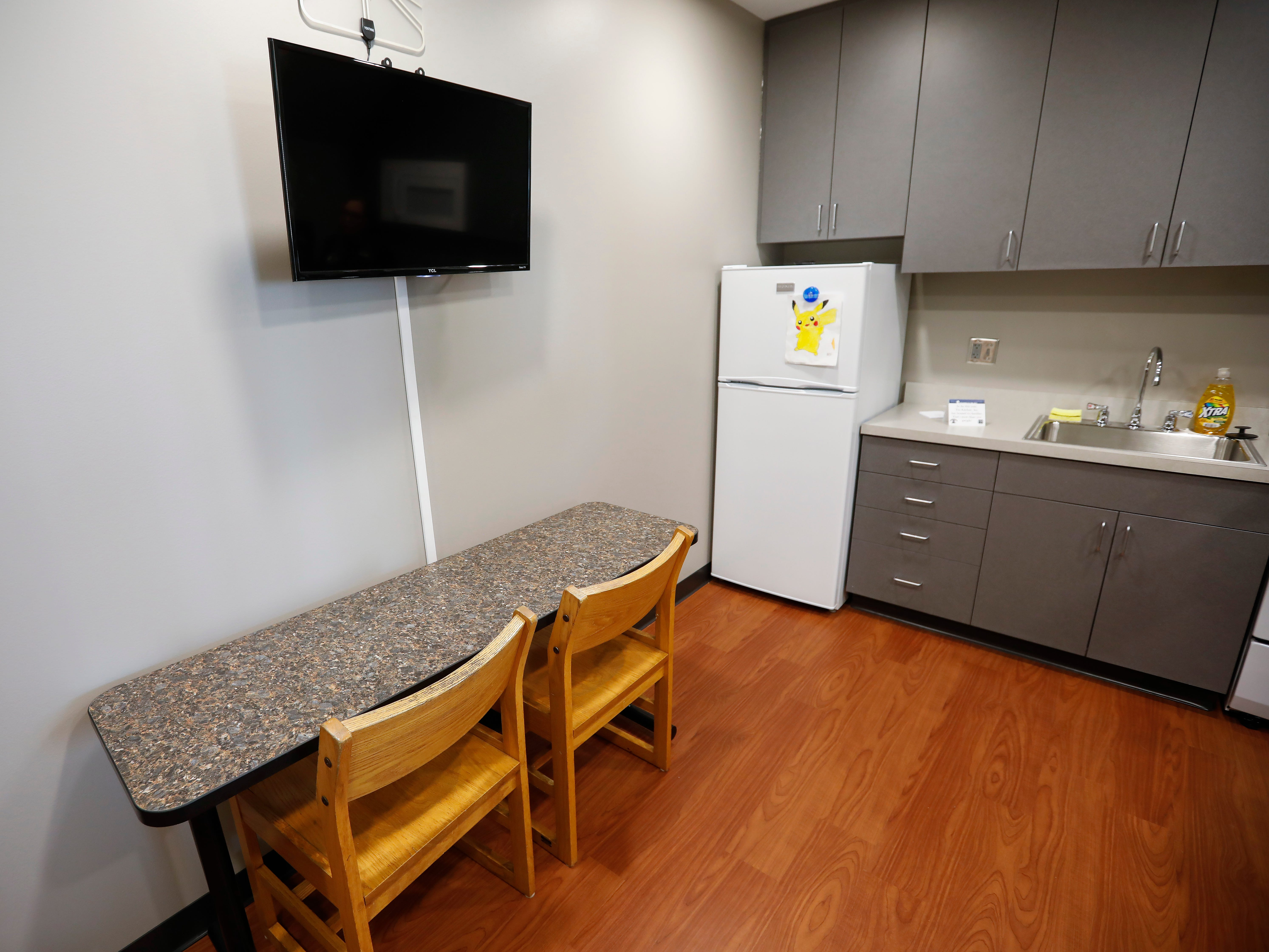 The television and kitchen area inside one of the apartments at The Kitchen's new Emergency Shelter located at 1855 E. Chestnut Expressway.
