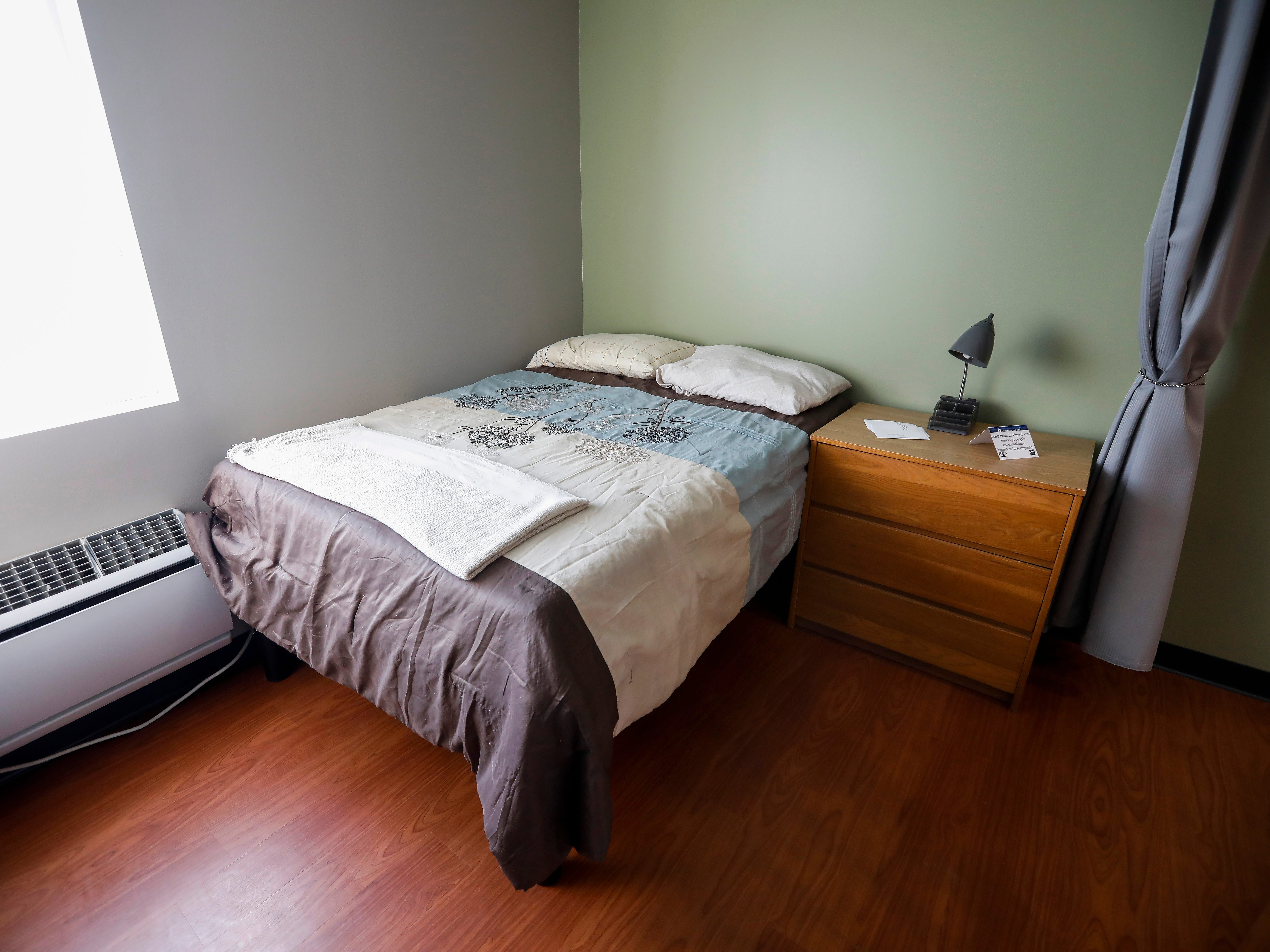 A twin bed inside one of the apartments at The Kitchen's new Emergency Shelter located at 1855 E. Chestnut Expressway.