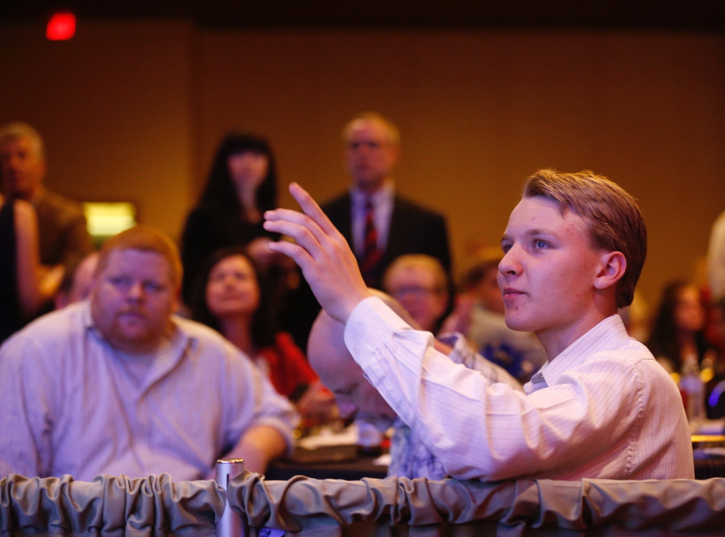 Adrik Fisher, 16, watches as election results come in at the Greene County Republican watch party at University Plaza.