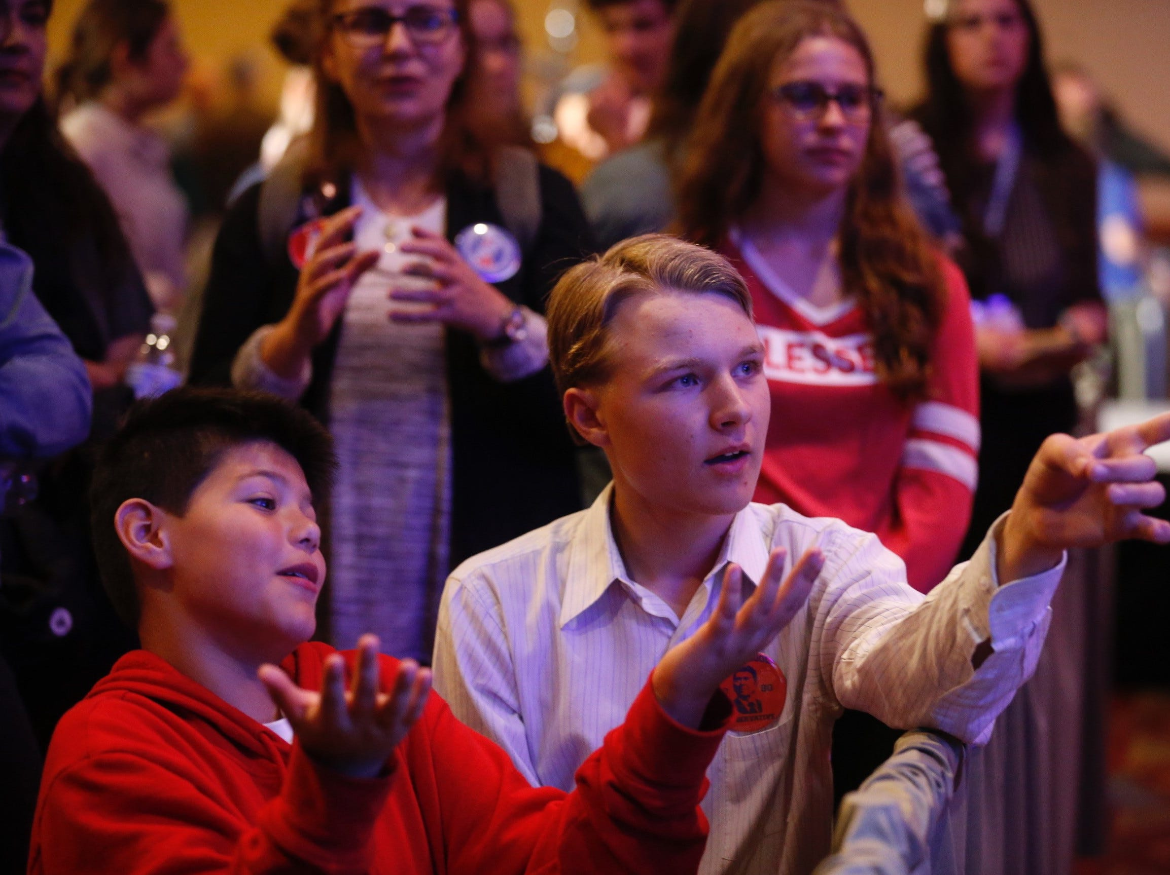 Adrik Fisher, 16, right, and Zachariah Lynch, 11, check on election results during the Greene County Republican watch party at University Plaza on Tuesday, Nov. 6, 2018.