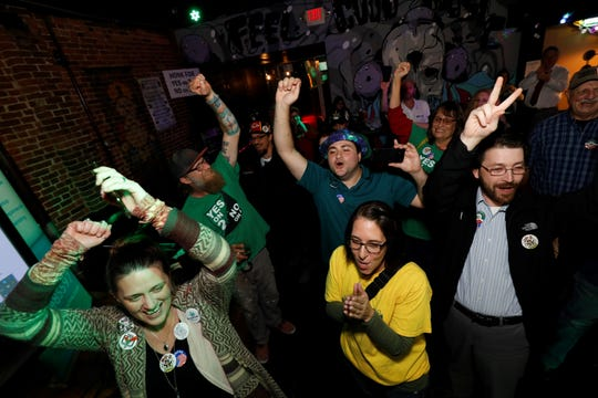 Advocates for Amendment 2 celebrate after Chip Sheppard, board member of New Approach Missouri, declares them a winner during a watch party Tuesday, Nov. 6, 2018 at Riad in downtown Springfield.
